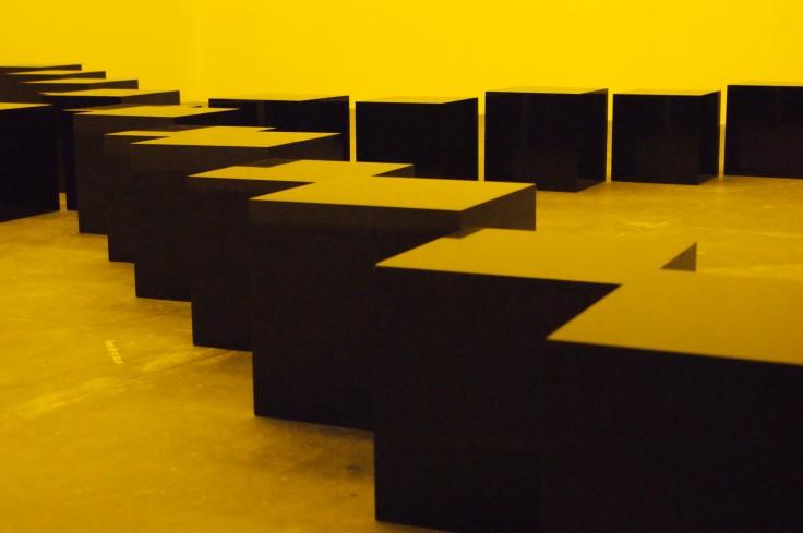 Bruce Nauman. Black Stones Under Yellow Light.